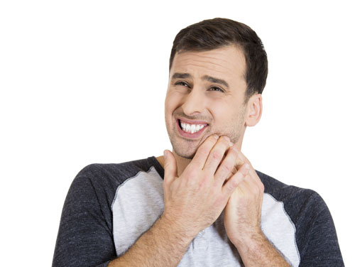 A man suffering from a sensitive tooth.