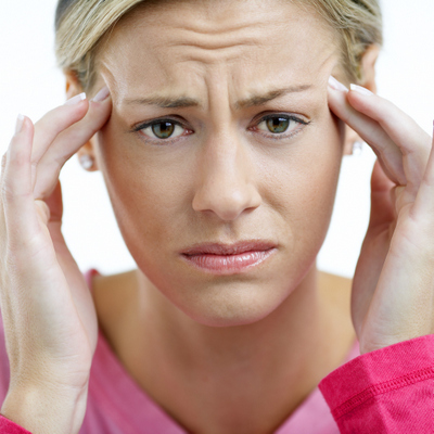 A woman suffering from her ears ringing caused by tmj!